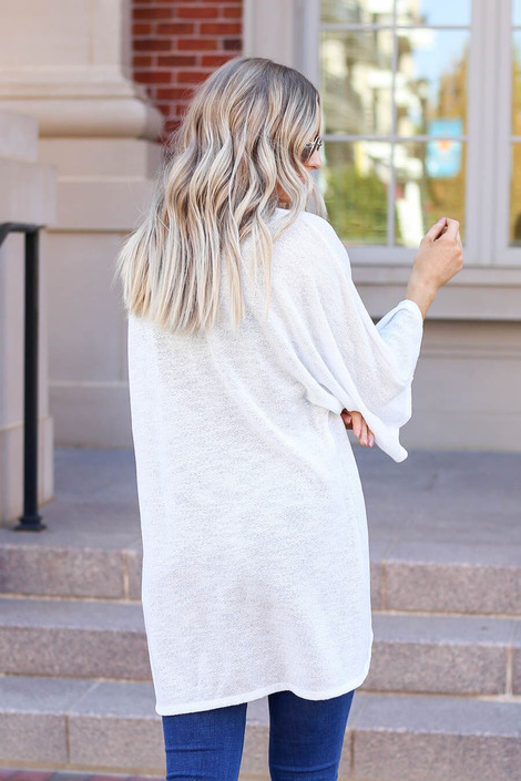 White - Model wearing the Jacie Lightweight Cardigan in white- back view