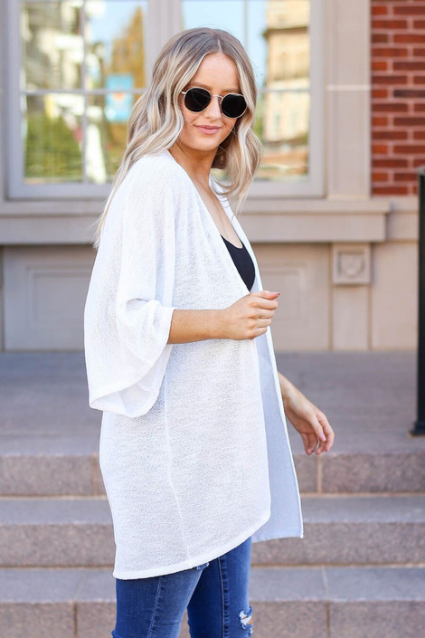 Model wearing the Jacie Lightweight Cardigan in white- side view