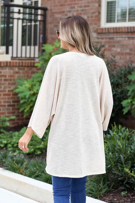 Model wearing the Jacie Lightweight Cardigan in natural- back view