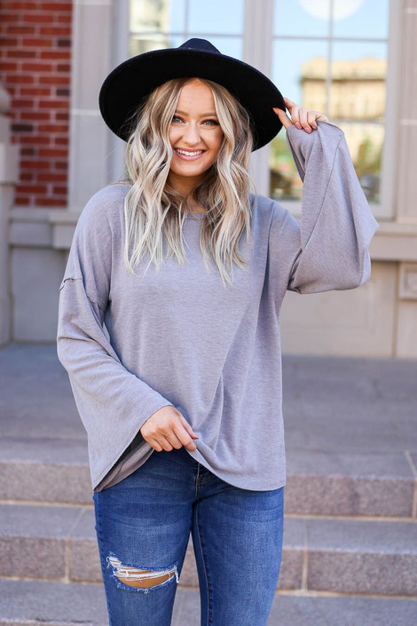 Model wearing the Halston Oversized Knit Top Front View in Grey
