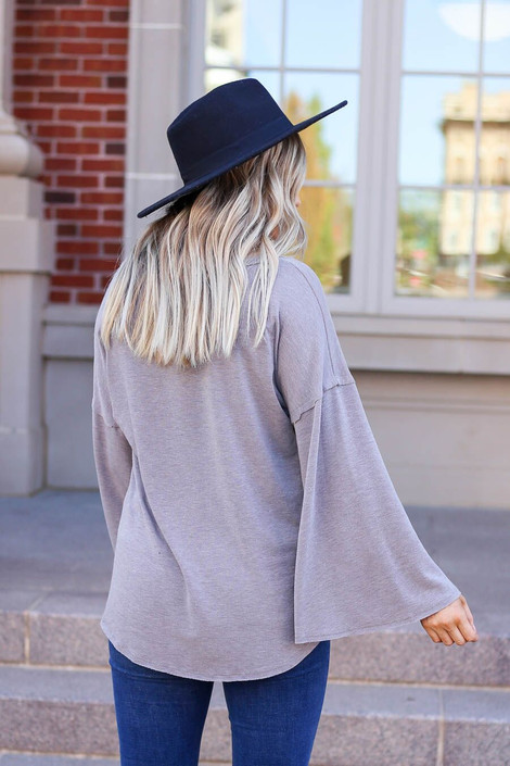 Model wearing the Halston Oversized Knit Top Back View in Grey