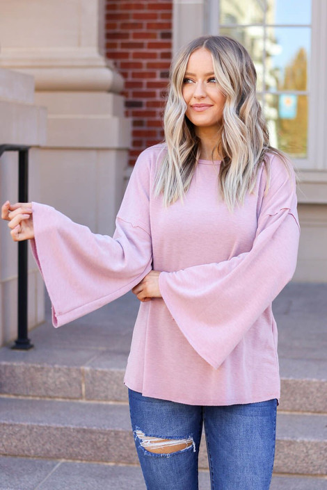 Model wearing the Halston Oversized Knit Top Front View in Mauve