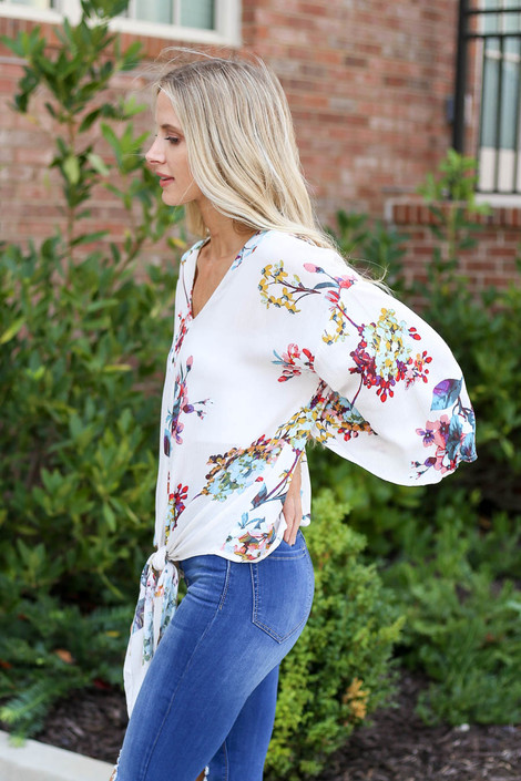 Model wearing the Erin Floral Tie-Front Blouse- side view