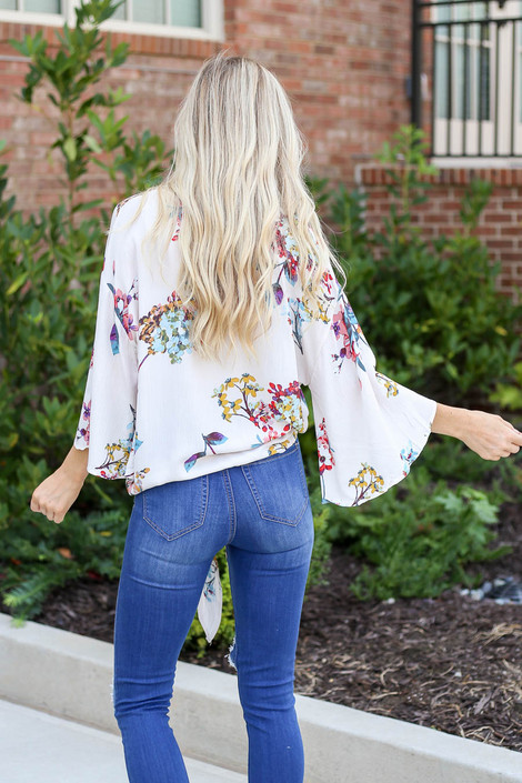 Model wearing the Erin Floral Tie-Front Blouse- back view