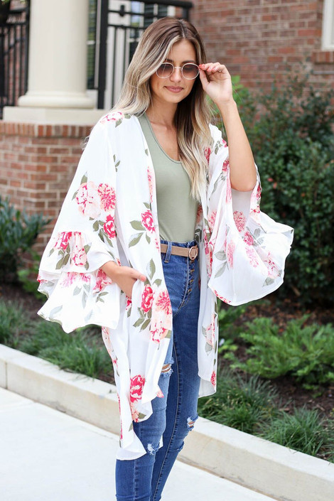 Model wearing the Dacey Floral Ruffle Sleeve Kimono in white front angle view
