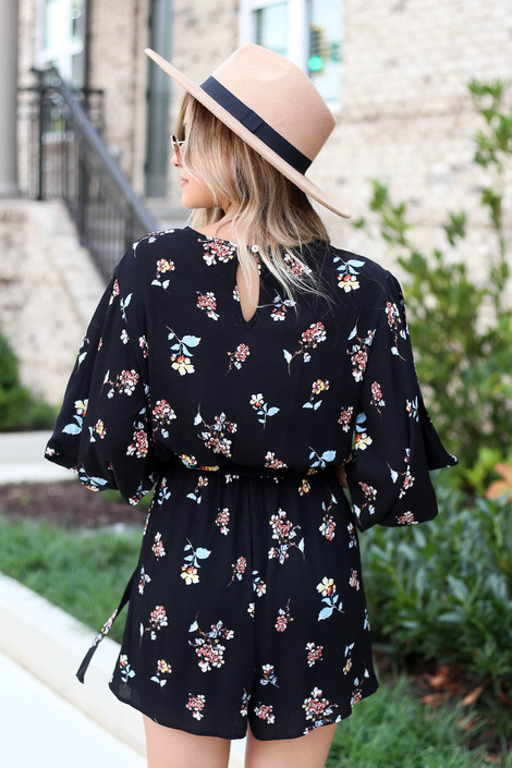 Model wearing Black Fall Floral Romper from Dress Up Back View