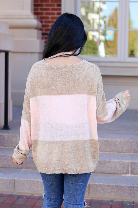 Model wearing Taupe and Blush Lightweight Color Block Sweater Back View