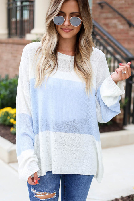Model wearing White and Blue Lightweight Color Block Sweater Front View