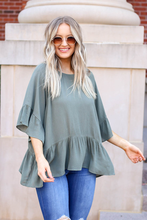 Dress Up Model wearing Olive Ruffle Sleeve Peplum Top