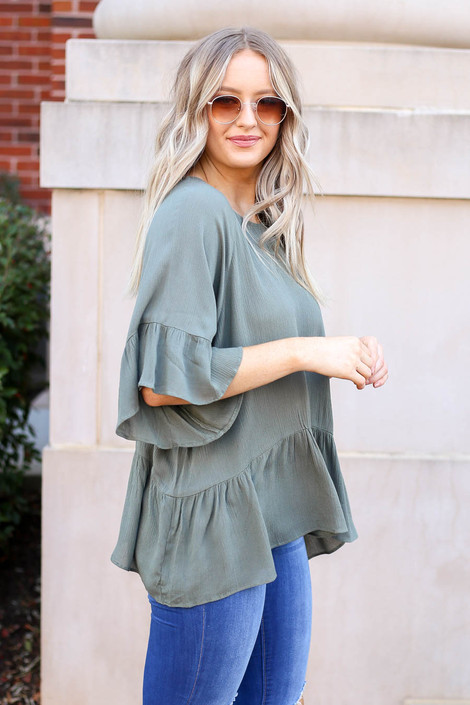 Dress Up Model wearing Olive Ruffle Sleeve Peplum Top Side View