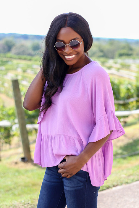 Dress Up Model wearing Purple Ruffle Sleeve Peplum Top Side View
