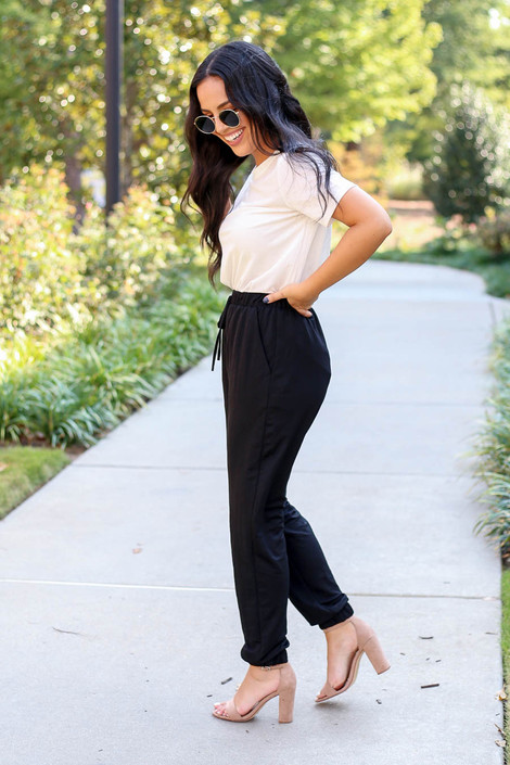 Dress Up Model wearing Black High Waisted Joggers Side View