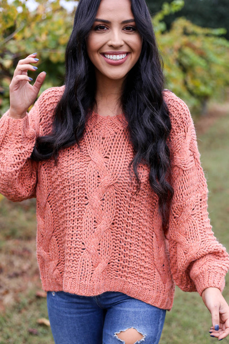 Dress Up Model wearing Rust Chunky Cable Knit Sweater