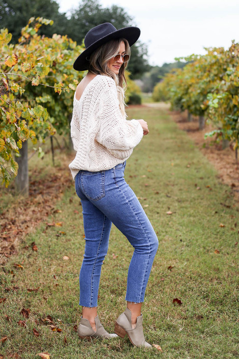 Dress Up Model at Chateau Elan wearing Medium wash Stretch Fit Mom Jeans Side View