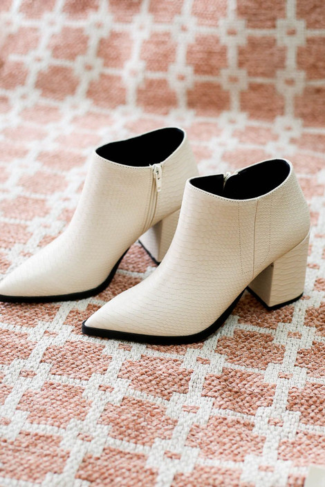 Flat Lay of White Pointed Toe Snakeskin Ankle Booties from Dress Up