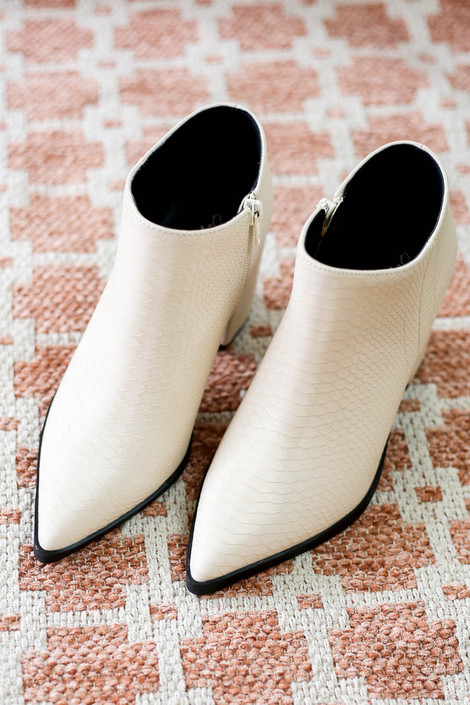 Flat Lay of White Pointed Toe Snakeskin Ankle Booties from Dress Up Detail View