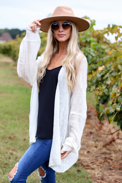 Dress Up Model wearing Ivory Lightweight Knit Baggy Cardigan Side View