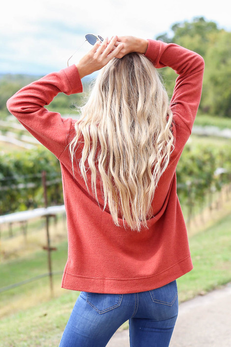 Dress up Model wearing Rust Split Hem Pullover Back View
