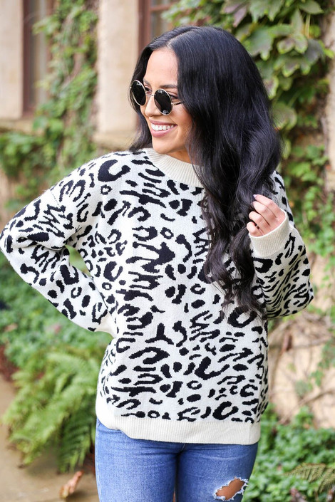 Model wearing Leopard Knit Sweater in white from Dress Up Boutique - Front View