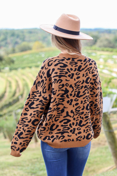 Model wearing Leopard Knit Sweater in camel from Dress Up Boutique - Back View