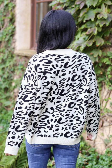 Model wearing Leopard Knit Sweater in white from Dress Up Boutique - Back View