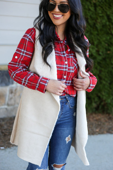 Model wearing the Faux Fur Vest in Ivory with high rise jeans and plaid flannel top Front View
