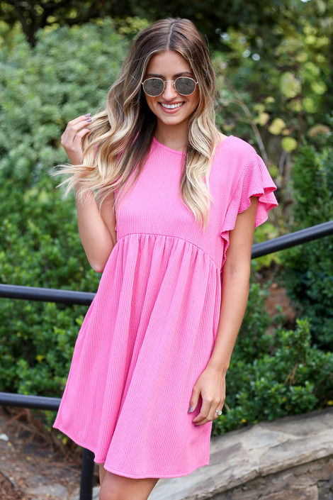 Dress Up Model wearing Pink Ribbed Ruffle Sleeve Ribbed Dress Side View