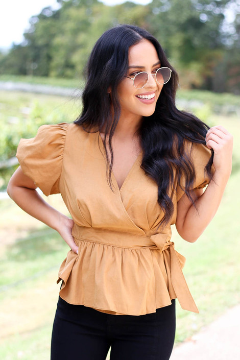 Dress Up Model wearing a Camel Puff Sleeve Wrap Top