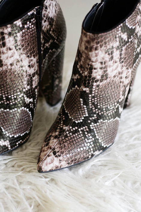Brown - Close up view of brown snakeskin point toe booties