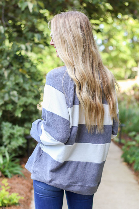 Model wearing Grey and White Striped Pullover Back View