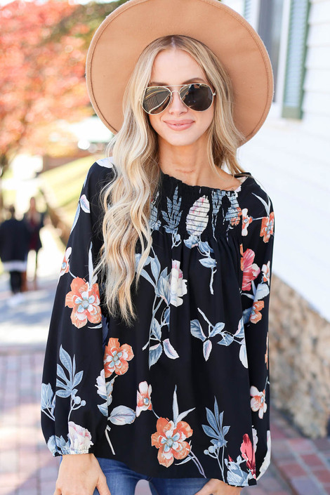 Dress Up Model wearing Black Long Sleeve Floral Smocked Blouse Front View