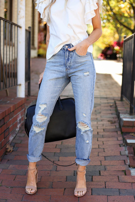 Model wearing Light Wash Distressed Mom Jeans Detail View