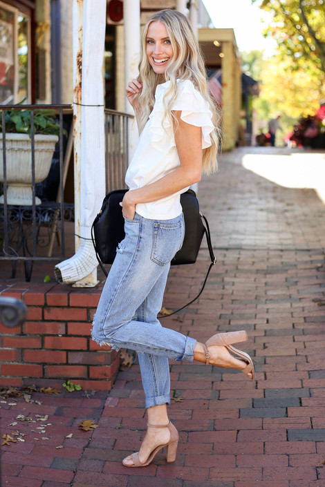 Model wearing Light Wash Distressed Mom Jeans Side View