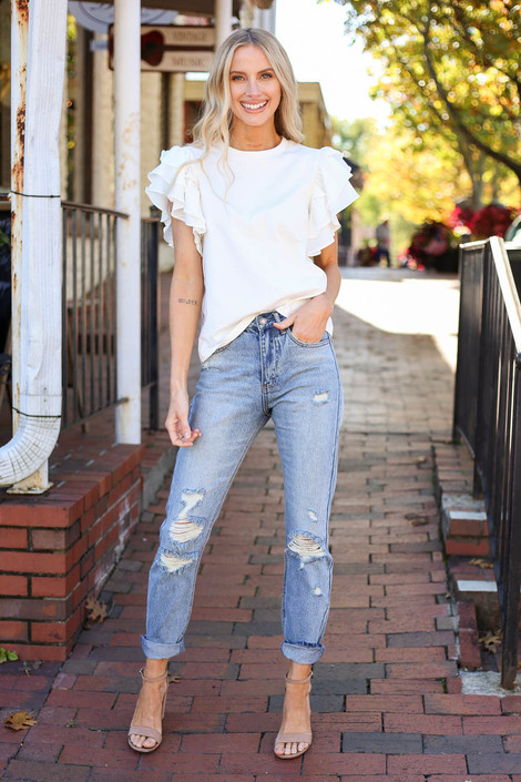 Model wearing Light Wash Distressed Mom Jeans Full View