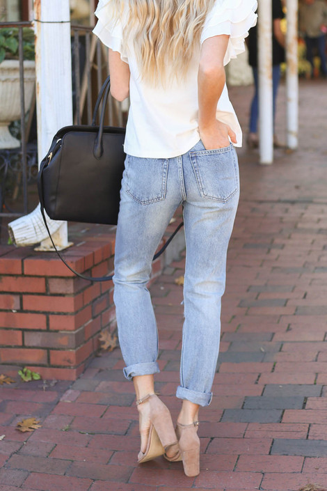 Model wearing Light Wash Distressed Mom Jeans Back View