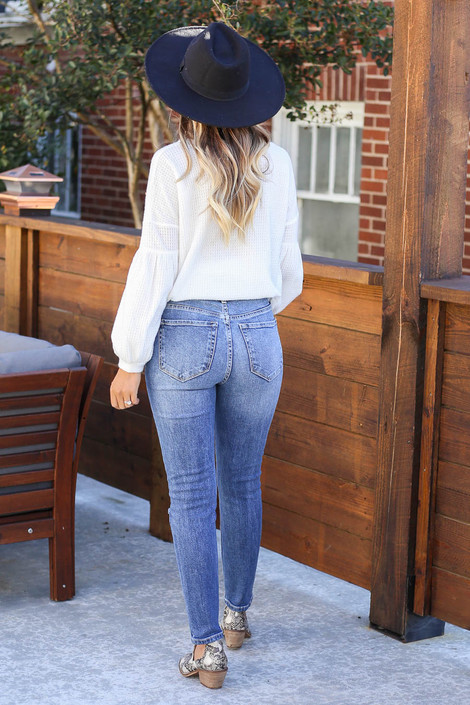 Dress Up Model wearing Medium Wash Distressed Stretch Fit Mom Jeans Back View