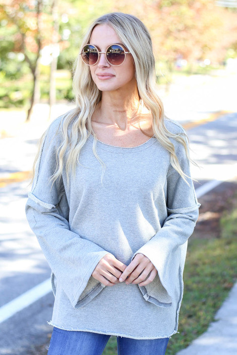 Model wearing Heather Grey Bell Sleeve Pullover Front View