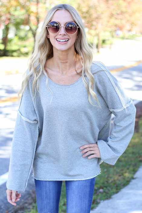 Model wearing Heather Grey Bell Sleeve Pullover