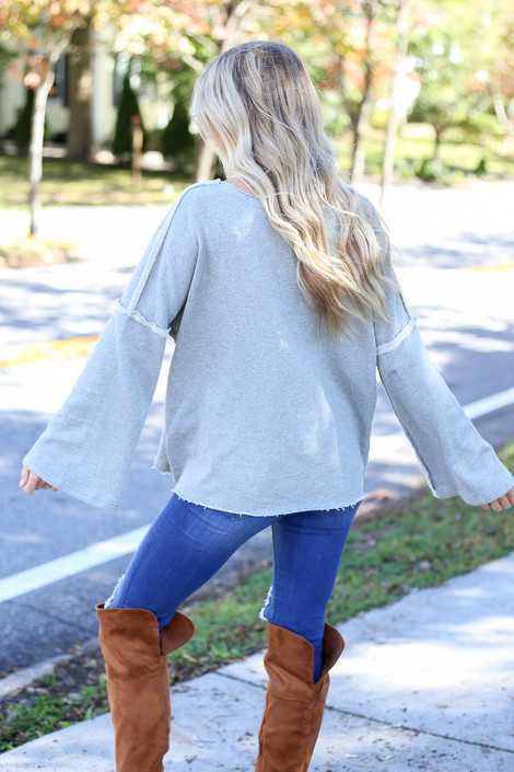 Model wearing Heather Grey Bell Sleeve Pullover Back View