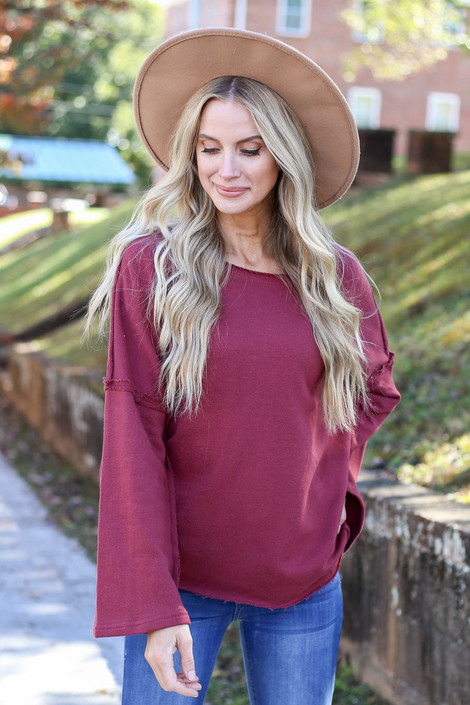 Model wearing Marsala Bell Sleeve Pullover Front View