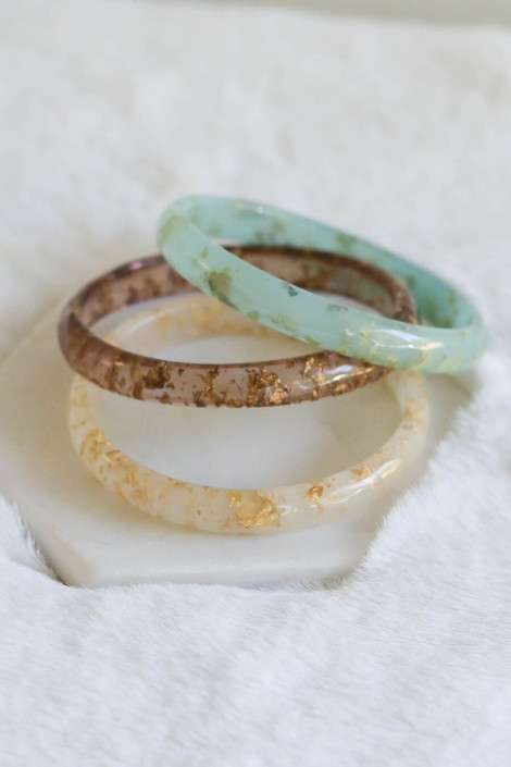 Acrylic Gold Flake Bangles in all three colors from Dress Up Boutique