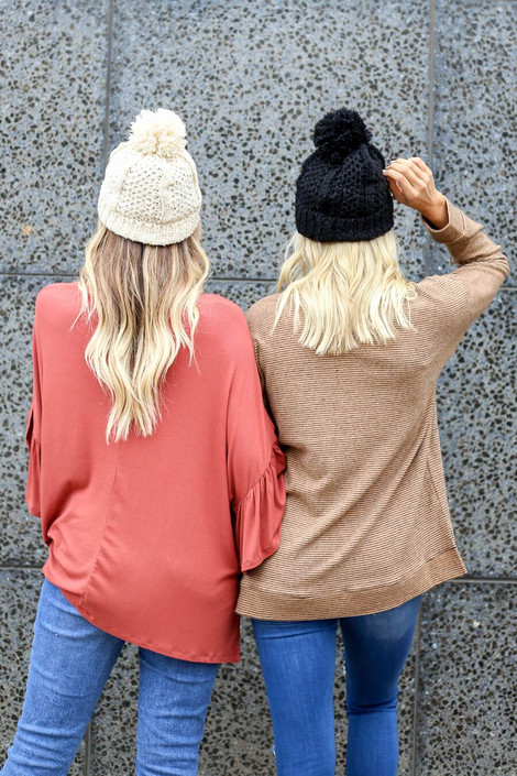 Dress Up Models wearing the Knit Pom Pom Beanie in Black and Ivory