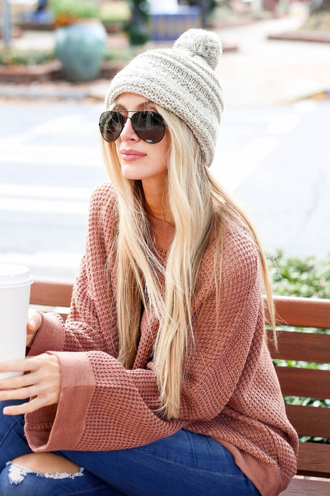 Model wearing the Knit Pom Pom Beanie in ivory from Shop Dress Up