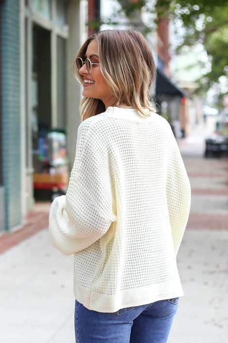 Model wearing the Loose Knit Wide Sleeve Sweater  in Ivory from Dress Up Boutique - Back View