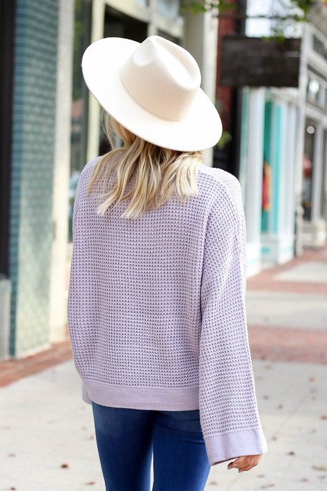 Model wearing the Loose Knit Wide Sleeve Sweater  in Purple from Dress Up Boutique - Back View