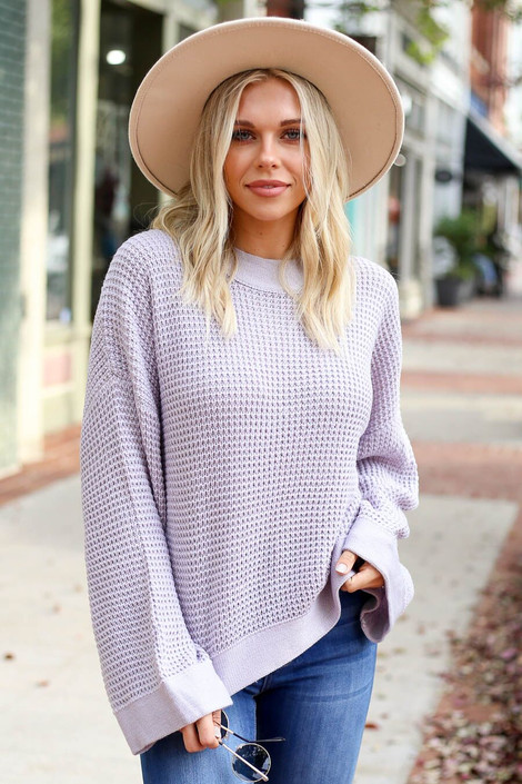 Model wearing the Loose Knit Wide Sleeve Sweater  in Purple from Dress Up Boutique- Front View