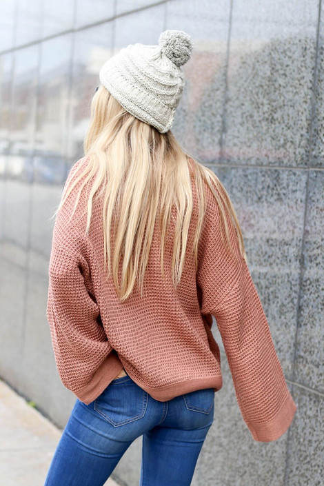 Model wearing the Loose Knit Wide Sleeve Sweater  in Blush from Dress Up Boutique - Back View