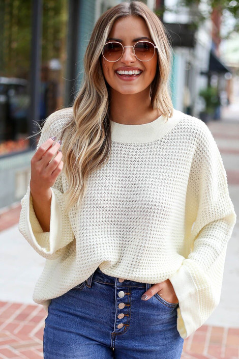 Front View of Model wearing the Loose Knit Wide Sleeve Sweater  in Ivory from Dress Up Boutique