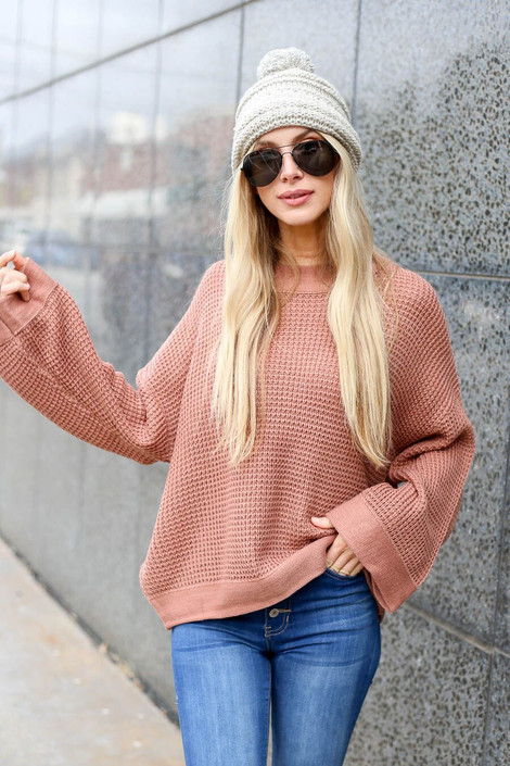 Model wearing the Loose Knit Wide Sleeve Sweater  in Blush from Dress Up Boutique - Front View