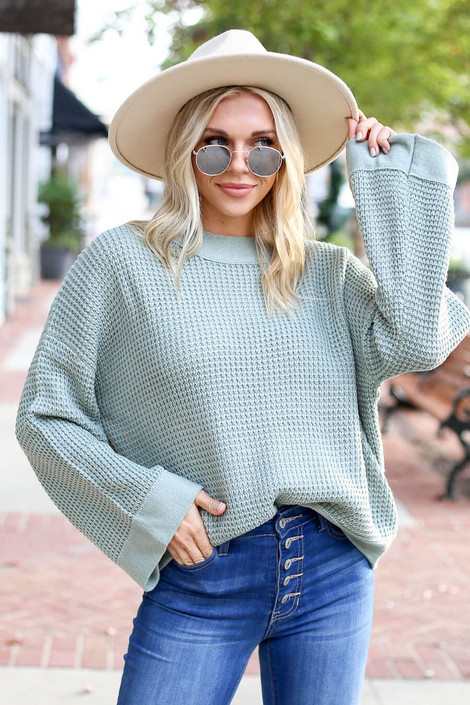Model wearing the Loose Knit Wide Sleeve Sweater  in Sage from Dress Up Boutique - Front View
